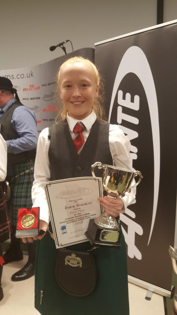 Aoife Bissett celebrates her win at the World Solo Drumming Championships in Scotland