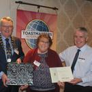 Left Pat Cregg (President Swords club) middle June Cooke (2nd place Fingal club) right Michael Madigan (Area Director)