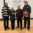 Cllr Adrian Henchy presenting the McCann family with their eponymous Cup