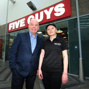 Pavilions Centre Manager Ian Hunter and Andrea Paul at the new Five Guys restaurant in the Pavilions, Swords