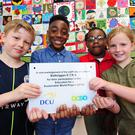 Balbriggan Educate Together NS 3rd class students students Euan, Jonathan, Diana and Robyn who were awarded by Dublin City University for their project on Sustainable Development