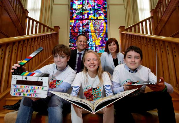 Cruinniúna nÓg Ambassadors, Sarah Fitzgerald (15) from Kinsale, Ben de Barra (13), left, from Skerries and Adam Cunningham (14) from Athenry present their credentials to Taoiseach Leo Varadkar TD and Minister for Culture,Heritage and the Gaeltacht, Josepha Madigan TD at Government Buildings (Pic: Mark Stedman)