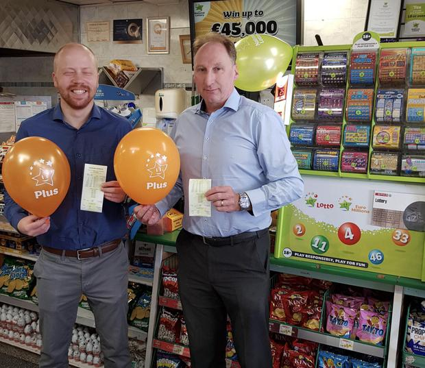 Michael Doyle (right), owner of the Spar store in Portmarnock, Co. Dublin celebrates after his store sold the winning ticket for lastTuesday night's EuroMillions Plus top prize which was worth €500,000.