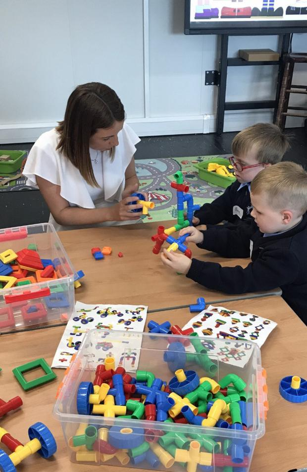 Teachers help pupils settle in at River Valley CNS.