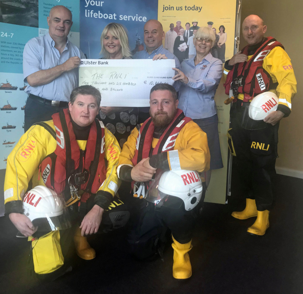 Deirdre King, Marketing Manager, Pavilions Shopping Centre and Ian Hunter, Centre Director presenting the RNLI with a cheque for€10,600. Representing the RNLI from left are Conor Walsh Divisional Maintenance Manager, Jan Doyle, Chairperson of Skerries RNLI Fundraising Branch, Skerries RNLI crewmember Steven Campion standing, and Skerries crew members Stephen Johnson and Paddy Dillon kneeling