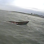 The capsized currach off Skerries