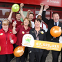 Staff celebrate selling the big winning ticket