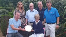 The McLoughlin family with the memorial plate presented to the winner of the Denise McLoughlin Memorial Golf Day