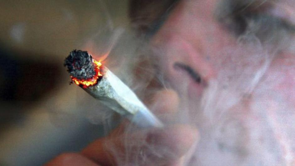Person smoking a joint (stock photo)