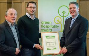 Martin Brittara from Bewley's Hotel collects the Green Hospitality Award from Maurice Bergin and James Hogan at an awards ceremony in the Radisson Blu Royal Hotel.