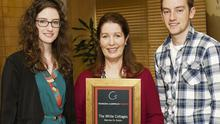 Georgina Campbell (centre) presents Jessica and Luke O'Connor, whose parents own The White Cottages B&B in Skerries, with the B&B of the Year Award at the Georgina Campbell Awards in Dublin. Picture: Paul Sherwood