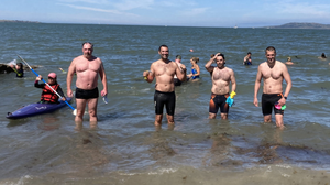 The hardy sea swimmers reach the end of their epic Velvet Six swim.