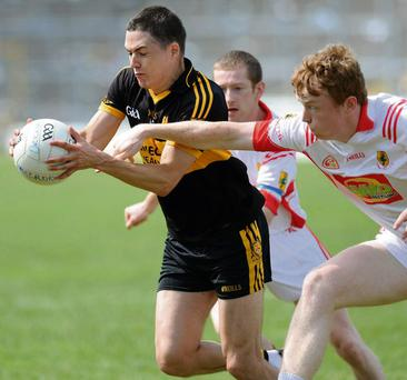 Brian Looney Dr Crokes challanged by Gary O'Sullivan East Kerry in the Garvey's SeperValu Kerry Senior Football Championship at Fitzgerald Stadium, Killarney on Sunday. Photo by Michelle Cooper Galvin.