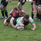 Captain Conor Caldwell dives over for a Balbriggan try. Picture: Caroline McFadden