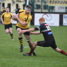 Conor Hurley tries to escape from a DLSP tackle