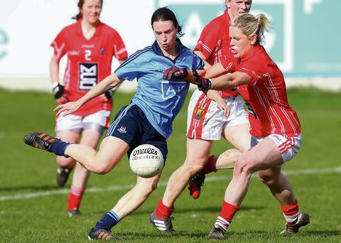 St Sylvester's forward Sinead Aherne scores Dublin's second goal despite the efforts of Cork's Angela Walsh during Sunday's Tesco HG NFL Division 1 game at Parnell Park. Picture: GAApics.com