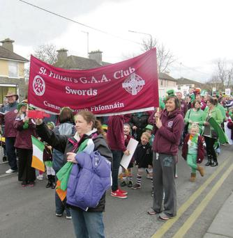 Emma Keely (right) and Grace Murray (left) holding the banner before leading the St Finian's participants at the St Patrick's Day Parade.