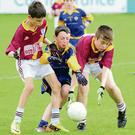 Ratoath's James McCann and is put under pressure by Joseph Whyte and Liam Doran.