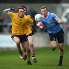 Ciaran Reddin of Dublin wins possession against Ryan Burns of DCU. Pictures: Cody Glenn/SPORTSFILE