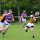 Naomh Mearnog's Mick O'Donoghue in action against Kilmacud Crokes.