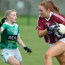 Amy Gibbons (O'Dwyer's) stands up to Trish Grehan as the Raheny player goes on a forward run during their championship final