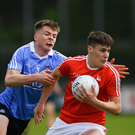 Skerries Harps clubman Adam Fearon tracks Louth's Ryan Walsh.