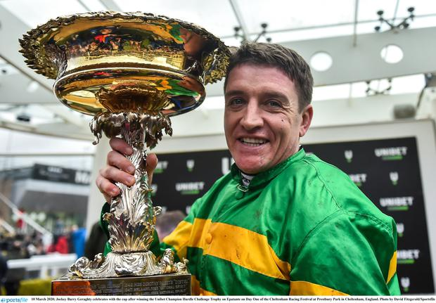 10 March 2020; Jockey Barry Geraghty celebrates with the cup after winning the Unibet Champion Hurdle Challenge Trophy on Epatante on Day One of the Cheltenham Racing Festival at Prestbury Park in Cheltenham, England. Photo by David Fitzgerald/Sportsfile