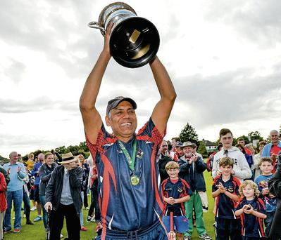 The Hills captain Nazeer Shoukat lifts the Bob Kerr Trophy