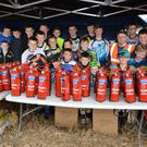 Paul Brangan (orange vest) Milverton Club President presents the youths with their fire extinguishers at the recent Stubble Championship. Photo courtesy balbriggan.info