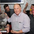 Baylon McCaughey (centre) is shocked to receive the Two Stroke Clubs Services to Sport award from Con Lawlor (left) and Joe Wright. Photo Megan Corry