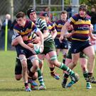 Thomas O'Hare attempts to offload in the tackle during Saturday's play-off game against Greystones