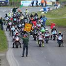 The'Engage Gear' sign is shown to the riders at the start of a brilliant Supertwin race. Photo Jack Corry
