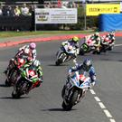 Superstock winner Ian Hutchinson leads the brilliant race that he went on to win at the North West 200. Photo Jack Corry