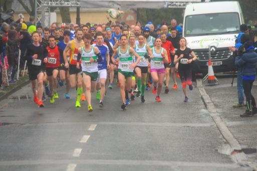 Runners brave the wintry weather as they embark on the Lusk AC 4-mile Road Race.