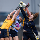 DCU goalkeeper and Fingallians club player Emer Ní Eafa and DCU teammates Katie Murray and Deirdre Geaney fight for possession with UCD's Karen at IT Blanchardstown. Photo: David Fitzgerald/Sportsfile