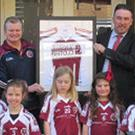 Hennessy & Perrozzi Solicitors of Town Centre Mall, Swords, have sponsored new jerseys for the St Finian's Under-8 girls and the team are pictured at the presentation of a framed jersey to John and Omar from the firm