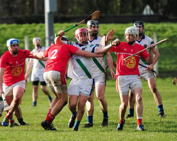 Play becomes a little congested in midfield during Saturday's St Sylvester's v Fingallians clash. Pictures: Fintan Clarke