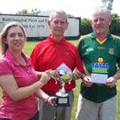 Mary Kennedy presents the Ballyboughal Pitch & Putt Club's Jack Fitzsimons Cup to Nick Savage, with the runner-up prize going to Seamus Dunphy