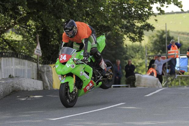 Paul O'Rourke is high flying over Ballaugh Bridge at the Manx Grand Prix. Photo: Baylon McCaughey