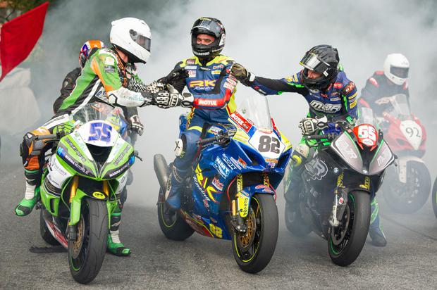 Derek Sheils (centre) is congratulated by Ray Casey #55 and Micko Sweeney #65 after winning the Grand Final at Munster and also the Irish Superbike championship. Photo Adam McMahon