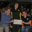 Margaret Corry presents the cheque from the Loughshinny club to injured riders Hugh Smith and Phillip McNally at the sidecar fundraising night. Photo Jack Corry