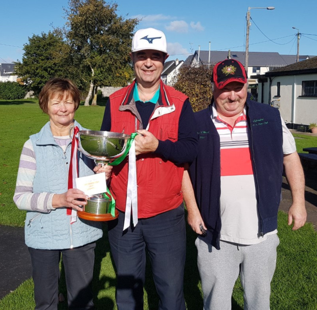 This year's winner of the George McDonnell Cup at Ballyboughal Pitch & Putt Club was Josie Cahill and she is pictured receiving the trophy from club secretary Ronnie Delaney, alongside runner-up Jimmy Browne