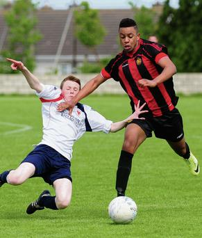 Carino Diaz of Malahide United stretches the Navan Road United defence during the Under-17 Mary Farrell Cup Final. Pics: Fintan Clarke
