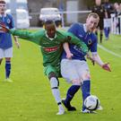 Glebe North's Kingsley Karakitie challenges Karl Russell of Bluebell United at Market Green on Friday evening. Picture: Fintan Clarke
