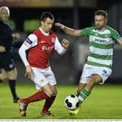 Keith Fahey, St Patrick's Athletic, in action against Stephen McPhail, Shamrock Rovers