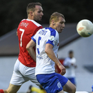 Swords native Conan Byrne (St Patrick's Athletic) challenges Yury Astraukh of Dinamo Minsk during their Europa League second qualifying round second leg tie at Richmond Park. The sides drew 1-1, but Minsk progressed 2-1 on aggregate. Photo:David Maher/Sportsfile