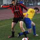 Malahide United's Timmy Doherty battles for possession with Tadhg Carney (Drumcondra) during Friday night's game at Santry Stadium. Picture: David O'Shea