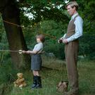 Will Tilston as Christopher Robin Milne and Domhnall Gleeson as Alan Milne in Goodbye Christopher Robin