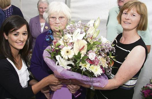 Making a floral presentation to Margaret were Laura Jordan (granddaughter) and Mary Frayne (daughter)
