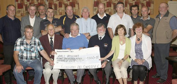 Eddie Sinnott (front centre) presents a cheque for €9,850 on behalf of Kilmuckridge RNLI Fundraising Committee to Rosslare Lifeboat represented by Fergus Wickham, Pat Busher and Dave Malone in Hammel's Lounge, Kilmuckridge.